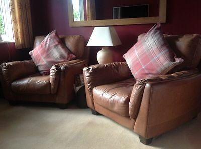 Pair of tan real leather air cushioned armchairs