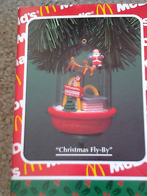 McDONALDS ENESCO CHRISTMAS FLY BY 1994 SANTA OVER GOLDEN ARCHES BOXED ORNAMENT