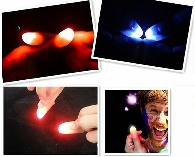 2 Magic Light Up Thumbs Coloured Red Finger Trick lights from anywhere Flashing
