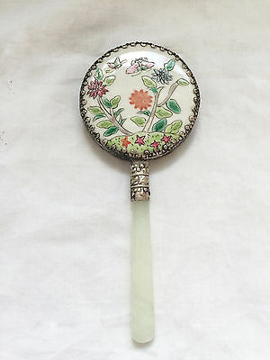 Enamelled hand held mirror