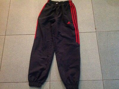 """Girls or Boys Adidas tracksuit bottoms. Size 24"""" (approx 9-10ys)"""