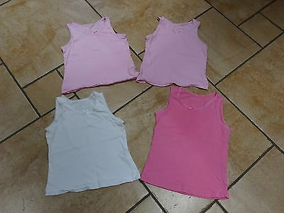 Four pink - white vests from Tu to fit 4-5 year old girl