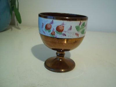 """4"""" tall ceramic goblet in copper lustre with white band showing strawberries."""
