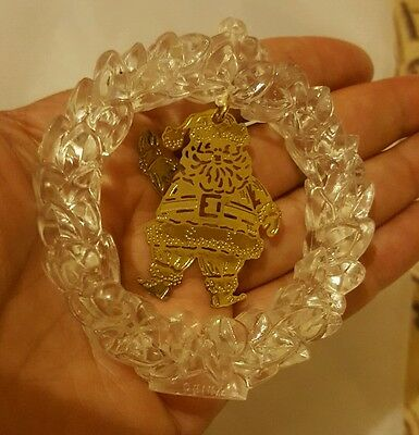 Clear plastic wreath Christmas tree ornament with waving santa claus in center