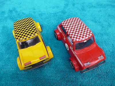 Vintage Scalextric Mini Coopers working condition.