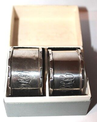 A  boxed pair of castlated solid silver napkin rings FHA&CO. Birmingham 1924