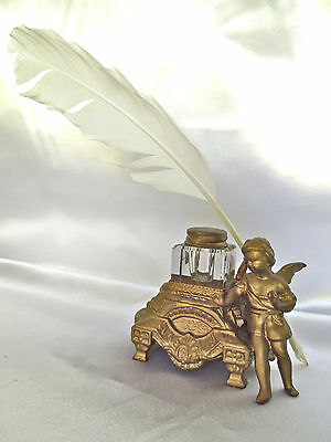 Antique Gilding Metal Boy Cherub Inkwell With Writing Feather.