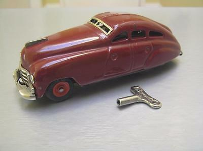 Schuco 1750 maroon windup car with key made in US Zone Germany