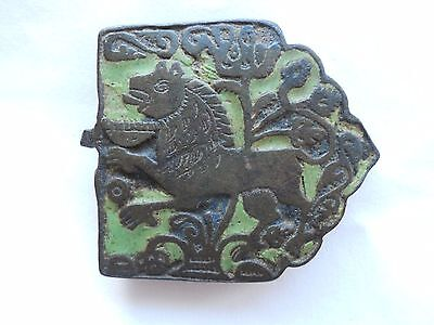 a rare 13th century zoomorphic lion  buckle