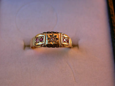 Ladies 18ct gold ring, diamond and ruby setting.
