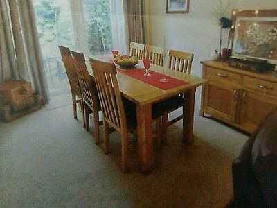 solid wood dining table with six solid wood chairs