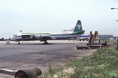 Original 1979 color airplane slide TIA Airlines Lockheed L-188 aircraft N852U