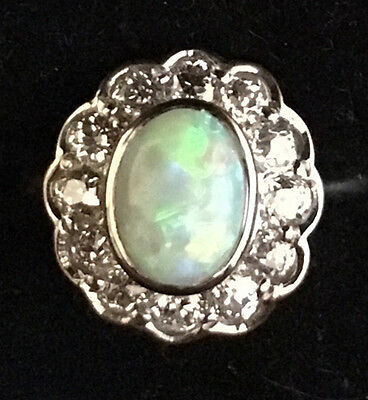 Opal and diamond ring (18ct yellow gold)