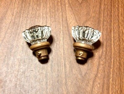 vintage pair of glass and brass door knobs