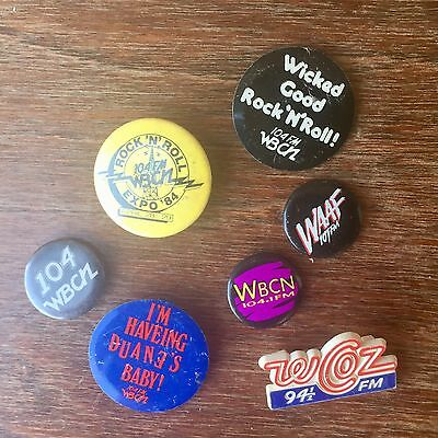 Collection of Seven Radio Station Pinback Buttons from the Seventies & Eighties