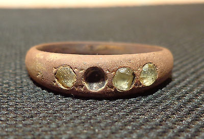 Bronze ring with four stones.