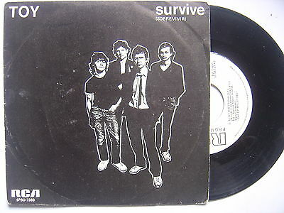 TOY survive / pin striped suits SPANISH 45 PROMO RCA 1981