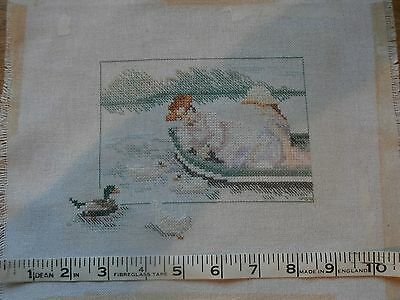 Completed cross stitch ladies in a boat