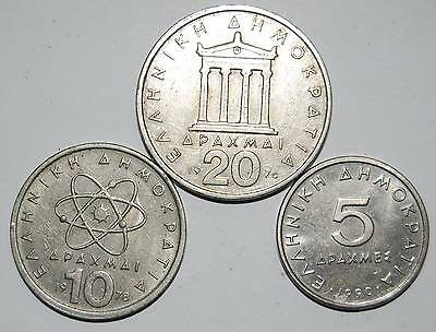 Three Greek coins prior to Euro currency.
