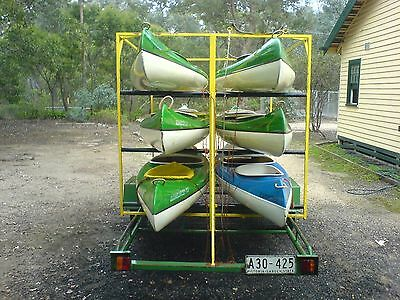 A Fleet Of 5 Rapidrider Canoes On Custom Built Trailer With Accessories