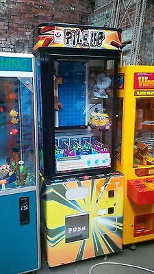 coin operated pile up game of skill arcade machine