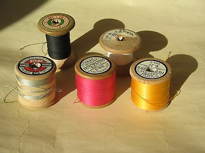 Five wooden vintage cotton reels, part used, various colours, Sylko, Singer