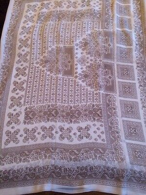 White Saree With Brown Printed Design