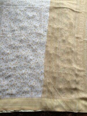 White Printed  Saree With Tan Front And Border. Flower Design.