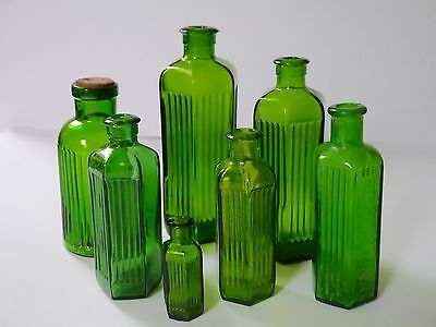 Collection of green glass pharmaceutical/chemist's bottles