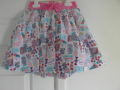 m&s used but immaculate a size 4-5 yrs and pink mix in colour lined skirt