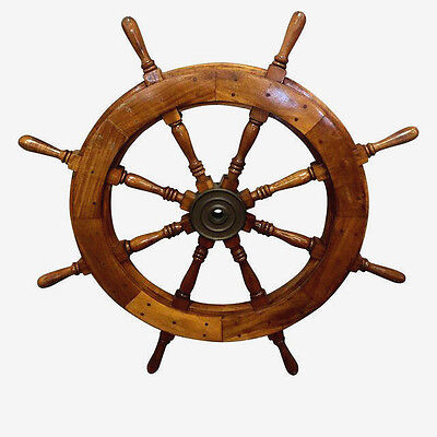 Teak ship's wheel featuring eight turned spokes with bronze hub.