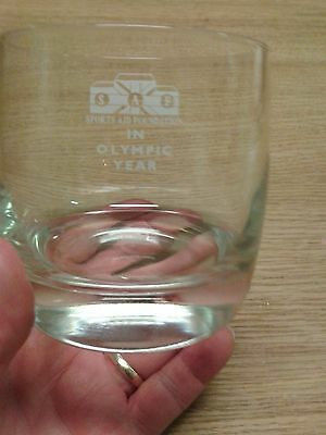 glass tumbler engraved with s.a.f sports aid foundation in olympic year