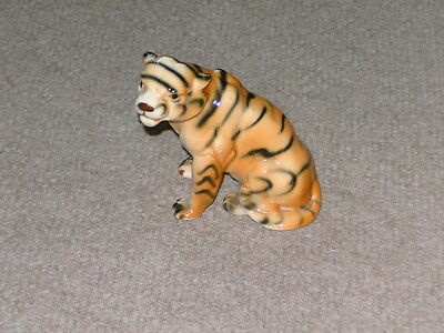 Wild cat. Porcelain sitting tiger fine quality figurine. Hand painted detail.