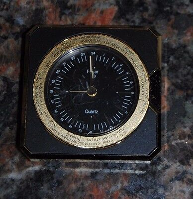 PULSAR WORLD TIME 24 HOUR ROUND DIAL QUARTz clock WITH GOLD TONE BLACK DIAL