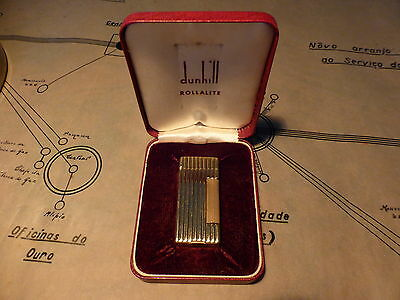 genuine Dunhill Rollalite  lighter. vertical lined pattern.In original box.