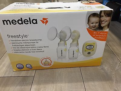 Medela Freestyle breast pump And Free Bottles