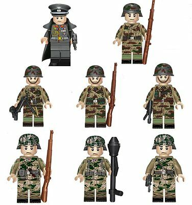 WW2 German soldiers in late war camouflage uniforms with weapons