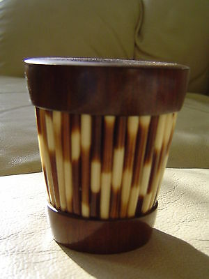 Wooden match holder with quill decoration