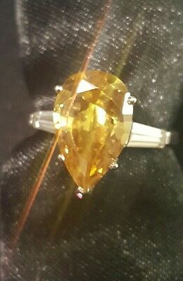 14kt White Gold Ring With Yellow Shape Stone.