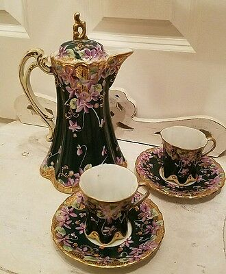 vintage victorian porcelain teapot and demitessie cups and saucers