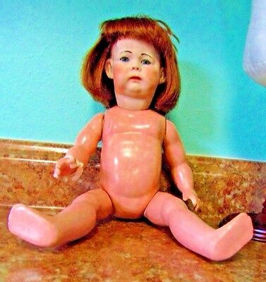 13 in.vintage bisque head and composition body doll