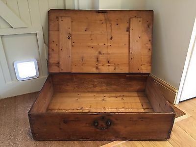 Pine antique chest or blanket box with casters.