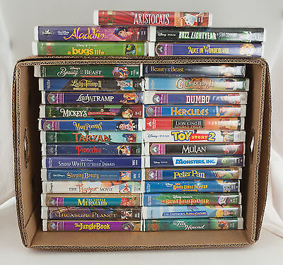 Lot of 31 Walt Disney Clam Shell VHS Tapes EUC Beauty Beast Lady Tramp Classics