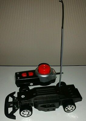 New Unused Meccano Remote Control Car Chassis and Matching Remote Control.