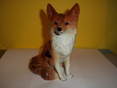Bone china ornamental sitting fox by Coopercraft. Used good condition