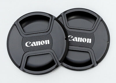 Two Canon 52mm Centre Pinch Lens Caps. Two for the price of one.