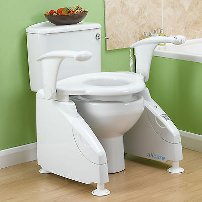 Powered Toilet Seat Raiser. Lowers to use the toilet, then Rises. Toileting Aid.