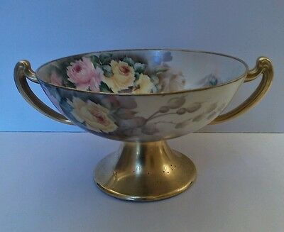 Hand painted pedestal fruit bowl. Artist signed, but unmarked.