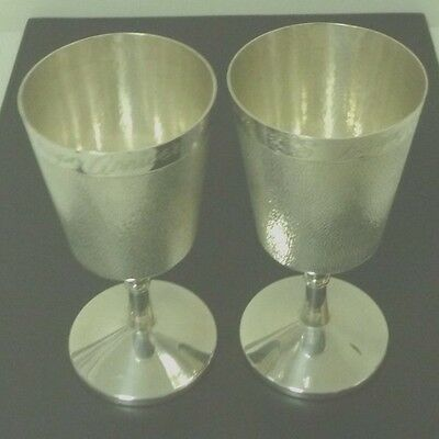 Pair of silver plated goblets, engraved happy anniversary.