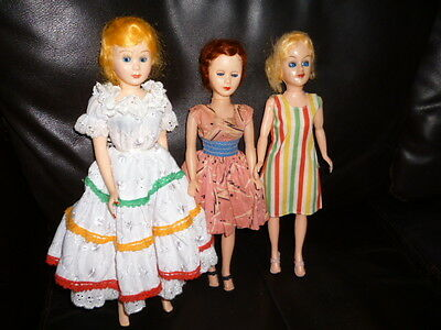 Three Vintage 1950's/60's Hard Plastic Fashion Type Dolls In Vintage Clothes.
